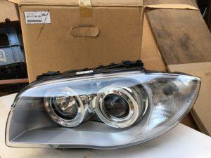 OEM 63117159301 - Faro anteriore bi xenon sinistro per BMW Serie 1 - 01